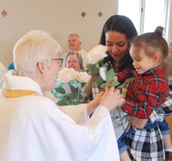 A flower for our new priest…
